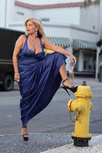 Woman by the fire hydrant — Stock Photo