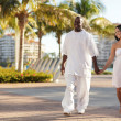 Young couple walking in the park — Stock Photo #5042798