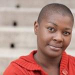 Headshot of a bald black woman — Stock Photo