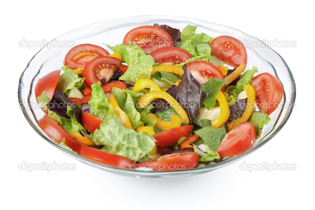 A glass bowl full of a variety of vegetables in a colorful tossed salad. — Stock Photo #3965073