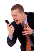 Man skrek åt cellphone — Stockfoto