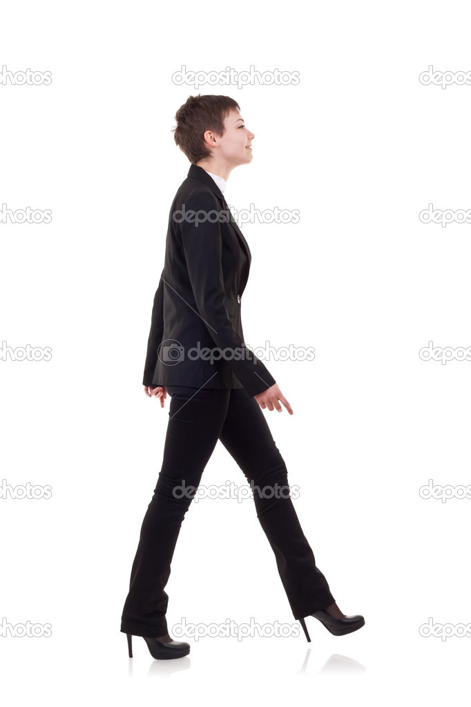Young Business Woman Is Walking She Is Smiling And Looking