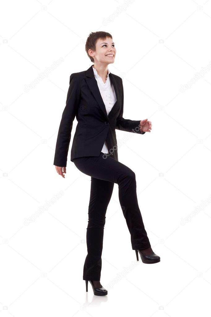 Young attractive business woman stepping on imaginary step  — Stock Photo #4084617