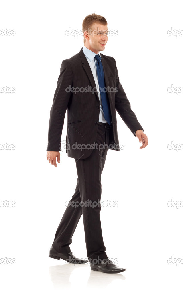 A young businessman is walking. He is smiling and looking away from the camera. isolated over white background  — Stock Photo #4084682