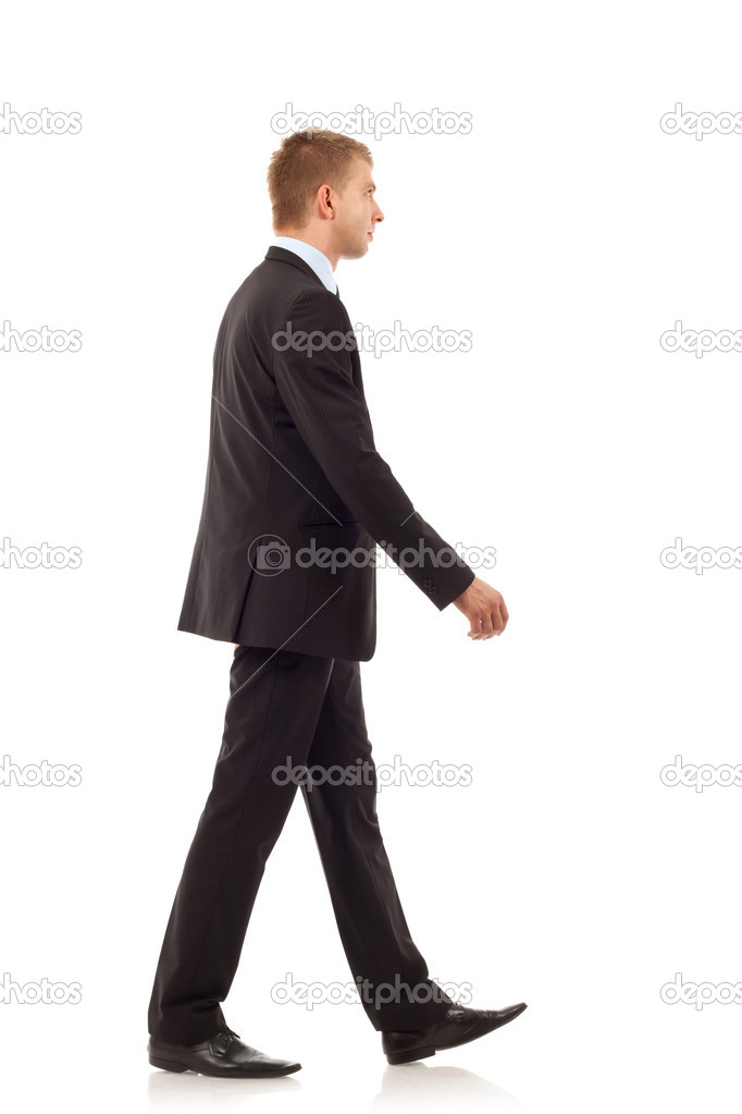 Portrait of a happy young business man walking on white background  — Stock Photo #4084684
