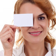 Woman holding blank card over her eye — Stock Photo #4198748