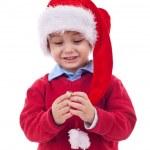 Santa kid playing with his cap — Stock Photo #4271577