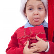 Santa kid sticking out tongue — Stock Photo #4271583
