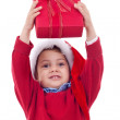 Stock Photo: Boy stretches out present