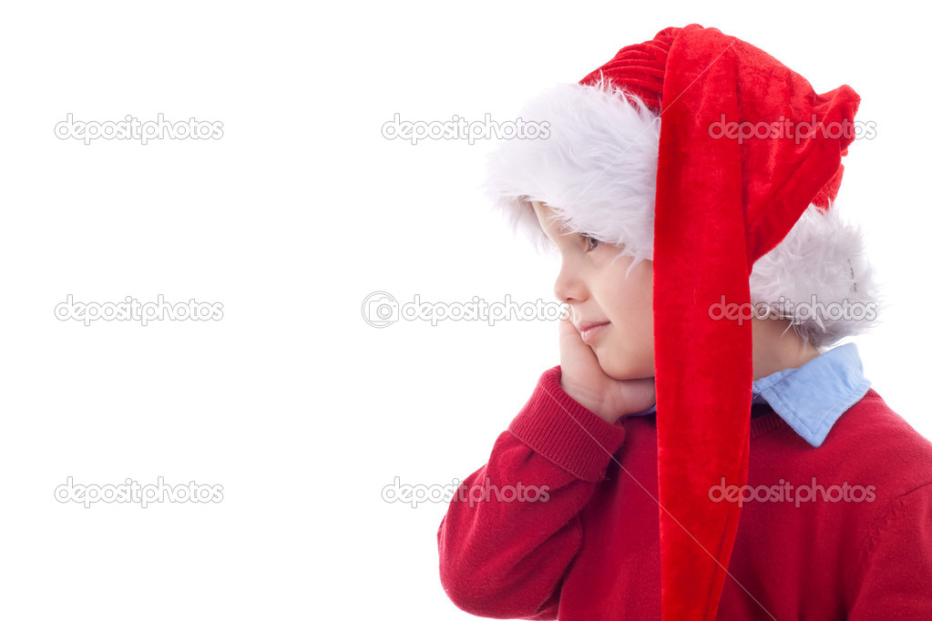 Funny child with Santa hat isolated on white background - side view  Stock Photo #4271580