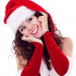 Girl in red dress and santa hat — Stock Photo