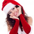 Girl in red dress and santa hat - Stock Photo