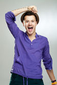 Excited young man wearing a hat — Stock Photo