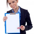 Business woman showing clipboard — Stock Photo