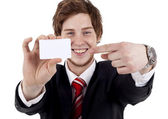 Business man showing a white card — Stok fotoğraf
