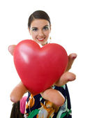 Woman handing a big red heart — Stock Photo