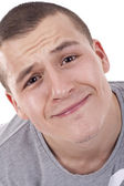 Handsome young man making a funny face — Stock Photo