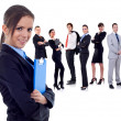 Business team with a businesswoman holding a clipboard — Stok fotoğraf