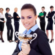 Winning businessteam, female holding trophy — Stock Photo