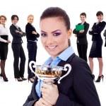 Winning businessteam, female holding trophy — Stock Photo