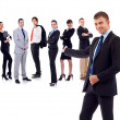 Businessman presenting his team - Stock Photo