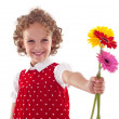 Smiling little girl giving flowers for mother's day - Stockfoto