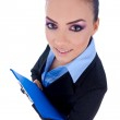 Business woman with a clipboard — Stock Photo