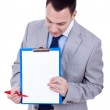 Business man showing clipboard — Stock Photo