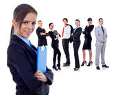 Business team with a businesswoman holding a clipboard — Stockfoto