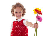 Smiling little girl giving flowers for mother's day — ストック写真