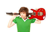 Guitarist with his guitar on shoulder — Stock Photo