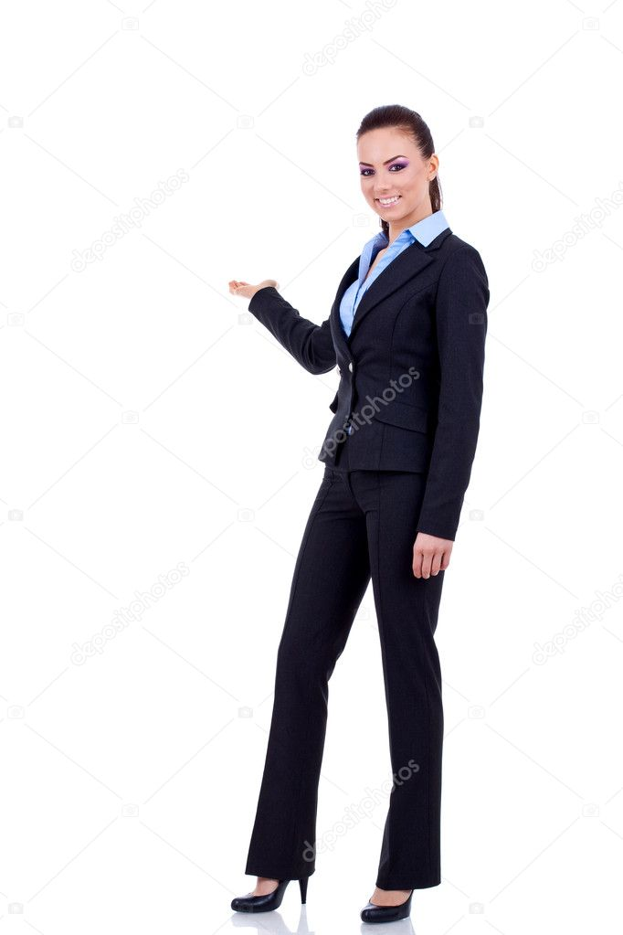 Business woman points at something in her back. Isolated on white background   Stock Photo #4997069