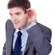 Business man cupping hand behind ear — Stock Photo