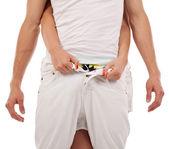 Woman unbuttoning a man's pants — Stock Photo