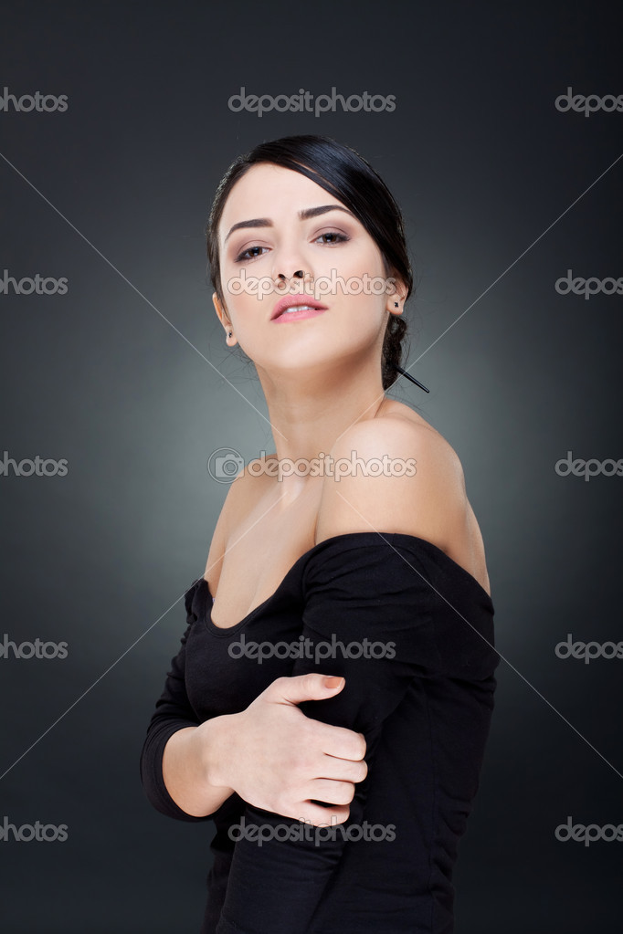 Sensual portrait of beautiful  woman looking over her shoulder  — Stock Photo #5122580