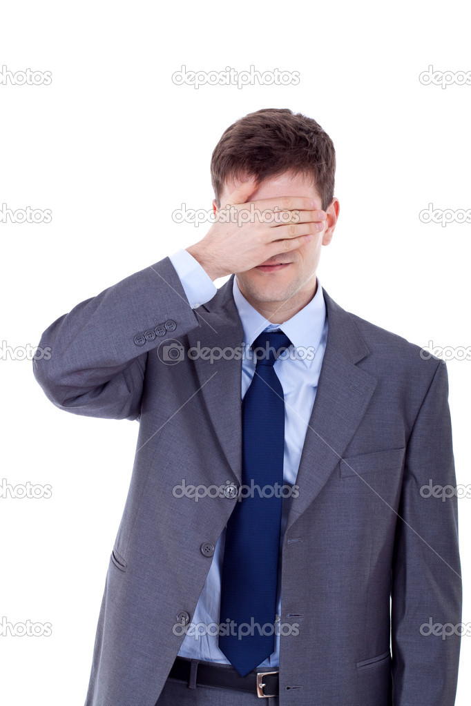 Business man making the see no evil gesture over white   Stock Photo #5122653