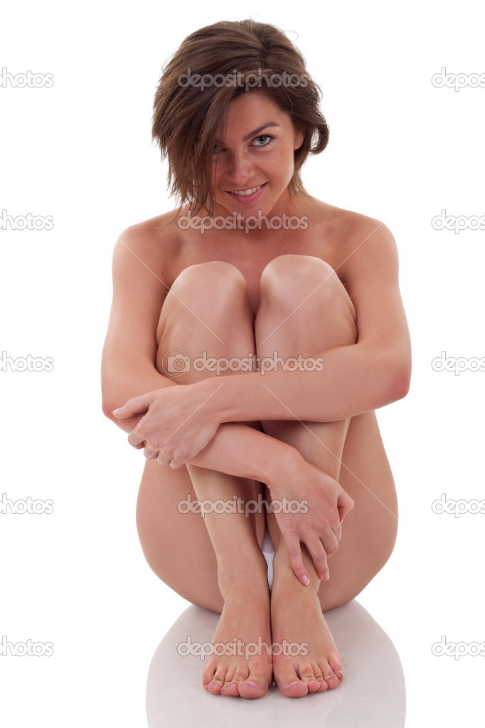 Naked woman sitting and embracing her legs, isolated on white background  — Stock Photo #5122833