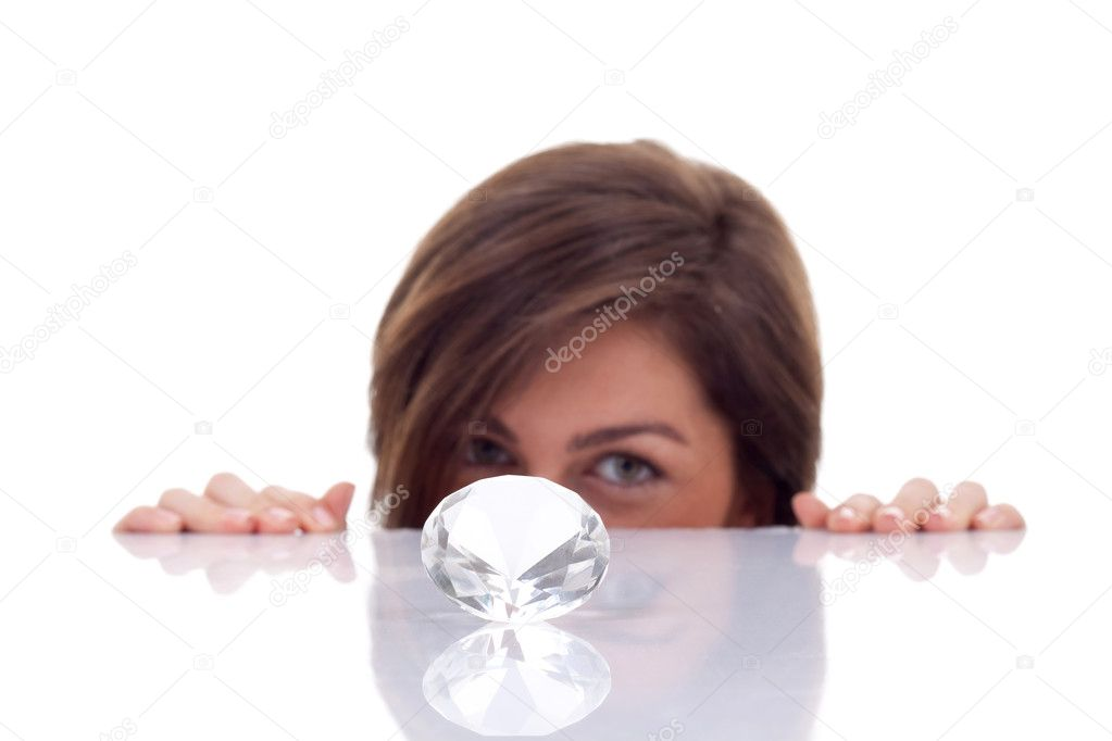 Beautiful young woman hidding behind the diamond over white background  — Stock Photo #5122856