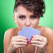 Sexy woman holding cards — Stock Photo