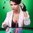 Stock Photo: Womwith poker face making bet