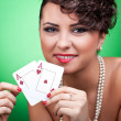 Royalty-Free Stock Photo: Sexy woman holding a pair of aces