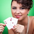 Sexy woman holding a pair of aces — Stock Photo #5231477