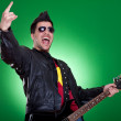 Guitarist making a rock and roll gesture — Stock Photo #5231490