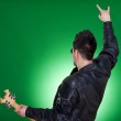Back of a heavy metal guitarist — Stock Photo #5231499