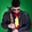 Guitarist in black leather jacket — Stock Photo #5231505