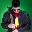 Guitarist in black leather jacket - Stock Photo