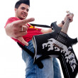 Musician with guitar gesturing rock sign — Stock Photo #5231549