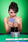 Amazing cards at poker table — Stock Photo