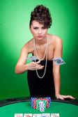 Woman winning at poker table — Stock Photo