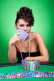 Woman at poker table — Stock Photo